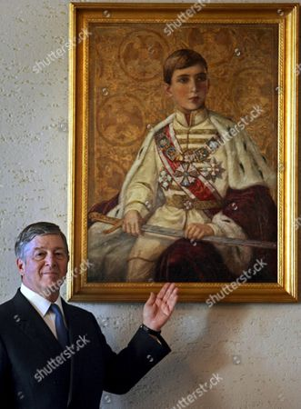 Serbia's Crown Prince Aleksandar Karadjordjevic Shows Picture of His Father Yugoslavia's Last King Peter Ii in His Home Royal Residence the White Palace in Belgrade On Wednesday 14 March 2007 the Remains of King Peter Ii of Yugoslavia Buried at the Serbian Orthodox Church Outside Chicago in Libertyville May Soon Be Exhumed at the Request of His Son Crown Prince Alexander and Reburied in Serbia
