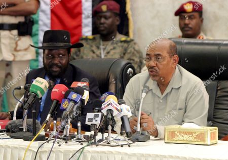 Sudan's President Omar Hassan Ahmad Al-bashir (r) Speaks As South Sudan Leader Salva Kiir (l) Listens During Their Meeting in Juba Southern Sudan On 27 August 2008 Al-bashir Went to Juba to Sign Contracts For Various Projects to Be Implemented in Southern Sudan Including Bids For the Construction of Three Power Dams in the South Also to Hold Talks with a Joint Council of Ministers to Review Implementation of the Comprehensive Peace Agreement