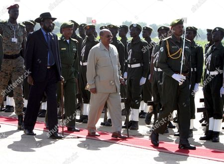 South Sudan Leader Salva Kiir (l) and Sudan's President Omar Hassan Ahmad Al-bashir (r) Review the Guard of Honor at Juba Airport Southern Sudan On 27 August 2008 Al-bashir Went to Juba to Sign Contracts For Various Projects to Be Implemented in Southern Sudan Including Bids For the Construction of Three Power Dams in the South Also to Hold Talks with a Joint Council of Ministers to Review Implementation of the Comprehensive Peace Agreement
