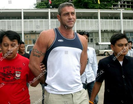 British National Christopher Alan Caunter 35 (c) is Escorted by Thai Police to a Press Conference at the Crime Suppression Division in Bangkok Thailand On Thursday 29 June 2006 British Police Had Been Searching For Caunter Since the Death of His Girlfriend Deborah Townsend Whose Body Was Found On a Road Last Year in Eastern England She Was Allegedly Pushed From a Moving Car and Run Over a Thai Police Said