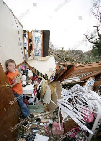 Michael Mckenzie (8) Stands in His What Was His Room Which Was Destroyed by a Tornado That Struck Early Sunday Morning in Newburgh Indiana; Monday 07 November 2005
