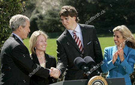 New York Giants Quarterback Eli Manning Shakes Hands with U S President George W Bush After He Spoke About the 'National President's Challenge' at the White House in Washington Dc Usa On 20 March 2008 Also Pictured Are Melissa Johnson (2-l) Executive Director of the President's Council On Physical Fitness and Sports and Fitness Celebrity Denise Austin the National President's Challenge is a Six Week Physical Activity Challenge Designed to Improve the Health of U S Citizens
