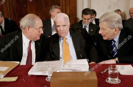 From L-r Sen Carl Levin (democrat- Michigan) Chairman of the Senate Armed Services Committee Sen John Mccain (republican- Arizona) and Sen John Warner (republican- Virginia) Talk Before a Hearing of the Committee On Capitol Hill in Washington Dc On Thursday 01 February 2007 the Committee Held a Confirmation For General George Casey Who is Nominated to Be the Next Army Chief of Staff Levin and Warner Have Come Together On a Compromise Resolution Against the Proposed Troop Surge in Iraq Mccain is Sponsoring a Competing Resolution Which Favors the Surge