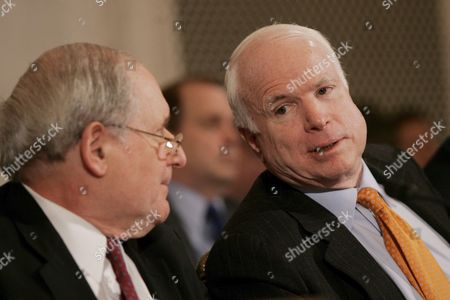 Sen Carl Levin (democrat- Michigan) Chairman of the Senate Armed Services Committee (l) Talks with Sen John Mccain (republican- Arizona) (r) During a Hearing of the Committee On Capitol Hill in Washington Dc On Thursday 01 February 2007 the Committee Held a Confirmation For General George Casey Who is Nominated to Be the Next Army Chief of Staff Levin and Sen John Warner (republican- Virginia) Have Come Together On a Compromise Resolution Against the Proposed Troop Surge in Iraq Mccain is Sponsoring a Competing Resolution Which Favors the Surge