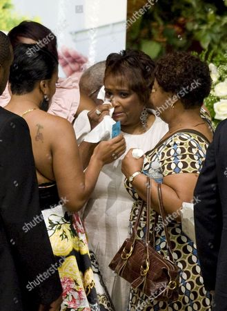 Rhonda Mccullough (r) is Comforted by Friends As She Stands Before a Picture of Her Husband Us Actor and Comedian Bernie Mac Before the Start of His Memorial Service at the House of Hope Church in Chicago Illinois Usa 16 August 2008 Mac 50 Died in a Chicago Hospital On 09 August From Complications Due to Pneumonia