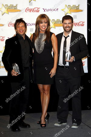 Us Dancer Mary Murphy Presents the Coca Cola Refreshing Filmmaker's Award to Jerome Sable (left) and Michael Montgomery (right) at the 2009 Showest Awards in Las Vegas California 2 April 2009 the Closing Night Ceremony For the 2009 Showest Features Top Film Industry Talent at the Final Night Banquet and Awards Ceremony