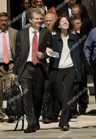 New York Times Reporter Judith Miller Smiles As She Walks with Times Publisher Arthur O Sulzberger Jr out of the Federal Courthouse in Washington Dc After She Testified Before a Grand Jury Ending Her Silence in the Investigation Into Whether White House Officials Leaked the Name of a Covert Cia Agent On Friday 30 September 2005 Miller Who Spent 85 Days in Jail Said She Agreed to Meet with the Grand Jury After Hearing From Her Source That She Should Cooperate with the Investigation by Special Counsel Patrick Fitzgerald