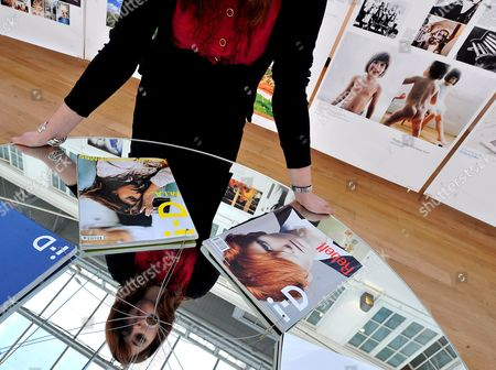 A Christie's Staff Looks Over Copies of Soul I-d Magazines at the Soul I-d Exhibit at Christie's in London Britain 02 March 2009 Christie's is Showcasing the Best of Fashion Music Art and Design in Soul I-d Including Ron Arad Giorgio Armani Bono Tracey Emin David Lachapelle Alexander Mcqueen and Yoko Ono in an Exhibition That is Celebrating a New 600 Page Book Entitled Soul I-d the Exhibition Will Travel Around the World For the Next Three Years