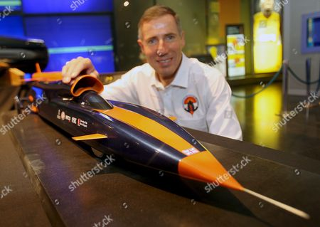 Andy Green with His Model of the Bloodhound Ssc at the Science Museum in London Britain 23 October 2008 a British Supercar Designed to Break the World Land Speed Record Has Been Unveiled and if It Succeeds the Driver Andy Green Will Be the First to Drive Through the 1000 Mph Barrier the New Car Called the Bloodhound Ssc Will Be 42 Ft Long 9 Ft High and Will Weigh 6 4 Tonnes and Boasts a Top Speed of 1 050 Mph It is Currently Being Designed by the Richard Noble and Will Be Driven by Andy Green a Royal Air Force Pilot the Pair Currently Hold the World Land Speed Title For Their Record Breaking Car Thrustssc Which Holds the Record Travelling at 766 Mph