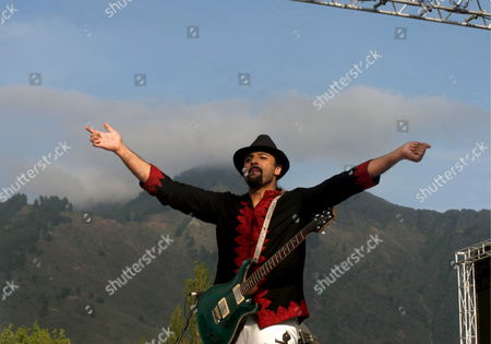 Salman Ahmad Lead Singer of Pakistani Rock Band Junoon Performs During a Concert in Srinagar Indian Kashmir 25 May 2008 Thousands of Strife Weary Kashmiris Usually Accustomed to Sound of Bombs and Rattle of Gunfire Screamed with Joy Clapped and Danced to the Beat of Music by Junoon the Concert Biggest Musical Event in the Disputed Kashmir Region in Nearly Two Decades in a Bid For Peace Was Held Amid Tight Security On the Banks of Region's Famous Dal Lake Ringed by Lofty Himalayan