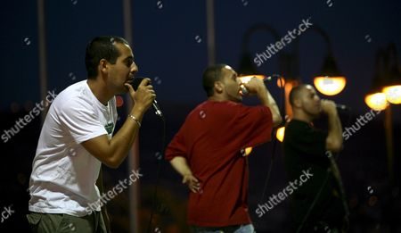 Members of Palestinian Rap Group Dam Perform During the Palestine Music Festival in the West Bank City of Nablus 22 July 2008 Dam is the First Palestinian Rap Group the Group Based in Israel Was Founded in 1998 and is Made Up of Three Palestinian Men: Tamer Nafar His Brother Suhell and Their Friend Mahmoud Dam Sings Primarily in Arabic But Also in English and Hebrew to Widen Their Audience Appeal Dam's 2001 Single 'Meen Irhabi? - Who's the Terrorist? Was Downloaded More Than a Million Times From Their Website the Group Has Also Delivered Their Message Outside Israel and the Palestinian Territories On Four European Tours