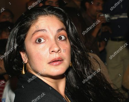 Stock Photo of Bollywood's Famous Actress Director Pooja Bhatt Looks at Photographers On Her Arrival in Karachi On Saturday 04 December 2004 Puja is in Karachi For the Premier of the Film 'Darakta Hay Ye Dil' (this Heart Throb) During Fourth Kara International Film Festival-2004