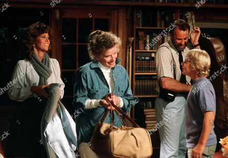 'On Golden Pond' Film - 1981 -  Thel Thayer, as played by Katharine Hepburn,, Chelsea, as played by Jane Fonda,, Bill Ray, as played by Dabney Coleman, and Billy Ray, as played by Doug McKeon, carrying bags and talking and laughing.