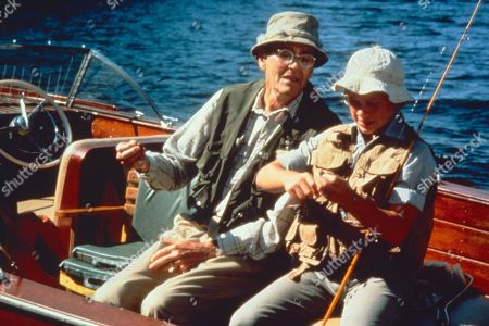 'On Golden Pond' Film - 1981 -  Norman Thayer, as played by Henry Fonda, and Billy Ray, as played by Doug McKeon, getting their fishing equipment ready on the boat.