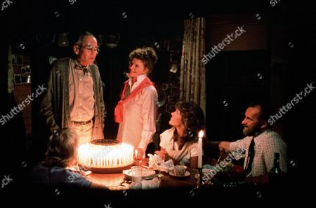 'On Golden Pond' Film - 1981 -  The Birthday Celebration with Thel Thayer, as played by Katharine Hepburn, and Norman Thayer, as played by Henry Fonda, who is blowing the candle out on the cake, watched by Chelsea, as played by Jane Fonda, Bill Ray, as played by Dabney Coleman, and Billy Ray, as played by Doug McKeon.