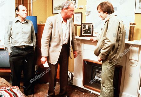 'Rising Damp'  Film - 1980 -    An Arguement takes place in the living room between Alan (Chris Strauli) and Cooper (Glynn Edwards) While Rigsby (Leonard Rossiter) watches on.