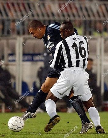 Stock Picture of Real Madrid's Ronaldo (l) in Action with Taribo West of Partizan Belgrade During Their Uefa Champions League Match in Belgrade On Tuesday 04 November 2003