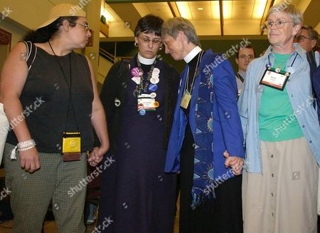 Stock Picture of A Group of Attendees to the General Convention of Protestant Episcopal Church Usa Gathered Outside the House of Bishops and Listen As They Announce the Election For Bishop of Rev Canon V Gene Robinson the First Openly Gay Candidate at the Minneapolis Convention Center the 05 August 2003 They Are From Left to Right Ana Hernandez Elizabeth Kaeton of Newark New Jersey Susan Russell of Pasadena California and Anne Brown of Vermont Epa Photo/epa/craig Lassig United States Minneapolis
