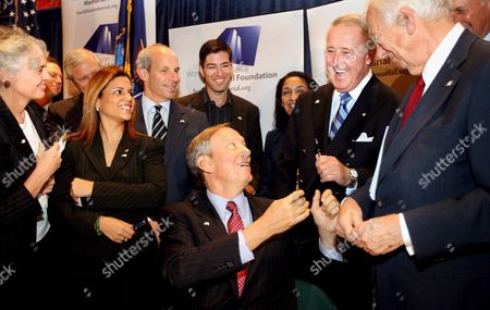 New York Governor George E Pataki Hands a Pen to the Former Prime Minister of Canada Brian Mulroney (2nd From R) After Signng a Bill Creating a New Voluntary Check-off Box On State Income Tax Forms That Allows New York Residents to Give to the World Trade Center Memorial Foundation On Thursday 20 October 2005 in New York Among Those Joining the Governor Were Foundation President and Ceo Gretchen Dykstra (far L) Memorial Designer Michael Arad (4th From R Glasses) and Foundation Chairman John Whitehead (r)