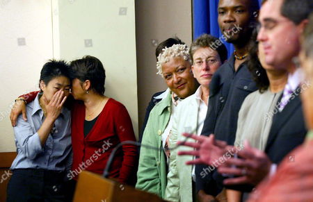 (l-r) Lead Plaintiffs Christy Chung is Comforted by Her Partner Lancy Woo Both of San Francisco As Other Co-plaintiffs Jewelle Gomez Her Partner Diane Sabin Both From San Francisco and Andre Lejeune of Los Angeles Listen to San Francisco City Attorney Dennis Herrera at the Press Conference Before a Hearing Challenging the Constitutionality of the State Marriage Law at the California Court of Appeal in San Francisco California Monday 10 July 2006