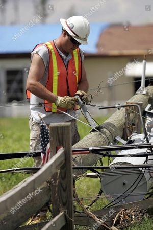 John Williamson of Pike Electric Works On a Down Power Line in Punta Gorda Florida Monday 16 August 2004 Damage From Hurricane Charley is Being Estimated at $15 Billion