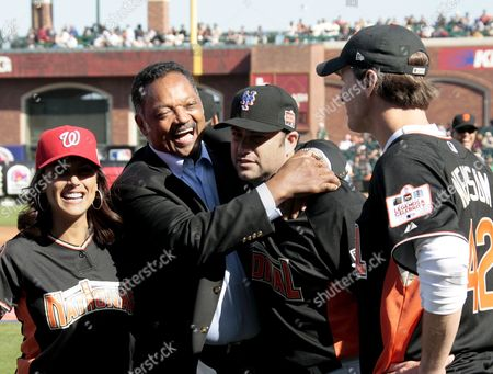 The Reverend Jesse Jackson (lc) Hugs Us Actor Jimmy Kimmel (rc) As Us Actress Leeann Tweeden (l) and San Francisco Mayor Gavin Newsom (r) Look On Before the Baseball All-stars Legends and Celebrity Softball Game at At&t Park in San Francisco California Usa 08 July 2007