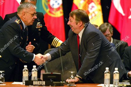 Belgian Defense Minister Andre Flahaut (r) Reaches Over to Greet Head of Nato's Military Committee German General Harald Kujat Prior to the Opening Session of the Nato Defense Ministers' Informal Two-day Conference at the Broadmoor Hotel in Colorado Springs Colorado Wednesday 08 October 2003 U S Secretary of Defense Donald Rumsfeld is Hosting the Event at the Posh Resort Outside of Colorado Springs