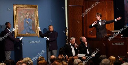 Sotheby's Auctioneer Tobias Meyer at Right Gestures During the Bidding For Pablo Picasso's 'Garcon a La Pipe' Seen at Left During an Auction at Sotheby's in New York Wednesday 5 May 2004 the Painting Sold For $104 1 Million Breaking the Previous World Auction Record of $82 5 Million Which Was Set by Van Gogh's 'Portrait of Dr Gachet' in 1990