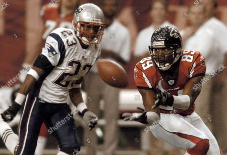 Atlanta Falcons Receiver Dez White (89) Looks to Catch a Pass While Being Defended by New England Patriots' Duane Starks (23) During the First Half of Their Football Game at the Georgia Dome in Atlanta Georgia Sunday 09 October 2005