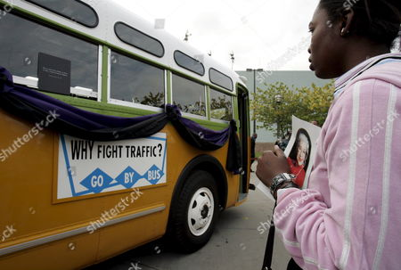Ameshia Patterson of Detroit Michigan Looks at the Actual Bus That Rosa Parks Refused to Give Up Her Seat That is On Display at the Charles Wright Museum of African American History in Detroit Michigan where She Lays in Repose On On Tuesday 01 November 2005 Parks' Refusal to Give Up Her Seat On a Montgomery Bus to a White Man Helped Break Racial Segregation in America Her Quiet Protest 50 Years Ago Led to a Revolt Against the Segregation of Whites and Blacks Parks Died at Her Home in Detroit at Age 92
