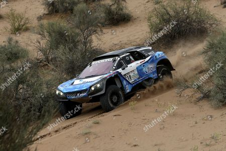 France's Romain Dumas drives his Peugeot  during the 11th stage of the Rally Dakar 2017 between San Juan and Rio Cuarto, Argentina, 13 January 2017.