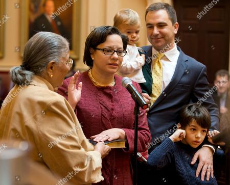 Jennifer McClellan, David Mills Lois McClellan State Sen. Jennifer McClellan, D-Richmond, second from left, is sworn in as her mother, Lois McClellan, left, holds the Bible, and her husband, David Mills, holds daughter Samantha and son, Jack, during the Senate session at the Capitol in Richmond, Va., . McClellan took th seat of US Rep. Don McEachin who was elected to Congress