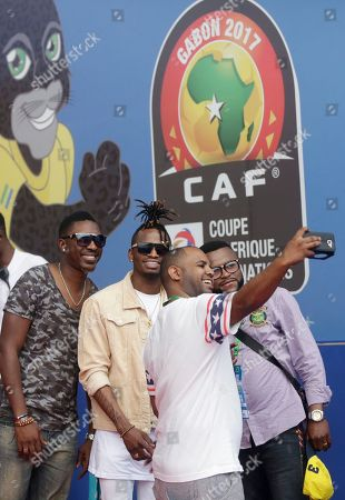 Stock Image of Tanzanian artist Diamond Platnumz and his dancers take a selfie at the Stade de l'Amitie, ahead of the opening ceremony and group A soccer matches between Gabon and Guinea Bissau at the Africa Nations Cup in Libreville, Gabon