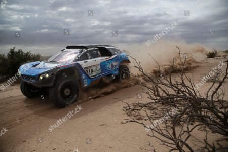 Romain Dumas, Alain Guehennec Driver Romain Dumas and co-driver Alain Guehennec of France race their Peugeot during the 11th stage of the Dakar Rally, between San Juan and Rio Cuarto, Argentina