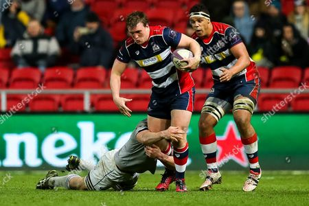 Jack O?Connell of Bristol Rugby is tackled by Paul Grant of Bath Rugby