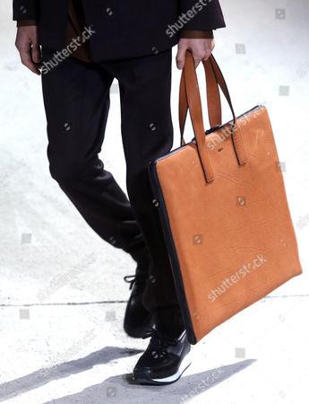 A model presents a creation from the Fall/Winter 2017-2018 menswear collection of Italian designer Alessandro Sartori for Italian fashion house Ermenegildo Zegna during the Milan Men's Fashion Week, in Milan, Italy, 13 January  2017. The Milano Moda Uomo runs from 13 to 17 January.