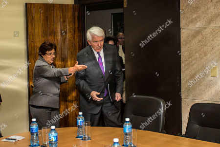 Cuba's Minister of Finance and Prices Lina Pedraza, left, leads Thomas Donohue, President and CEO of the U.S. Chamber of Commerce before a meeting in Havana, Cuba