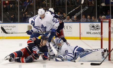 New York Rangers left wing Chris Kreider (20) looks for a rebound as he tries to score on Toronto Maple Leafs goalie Frederik Andersen (31) during the second period of an NHL hockey game, in New York. Kreider scored on the play