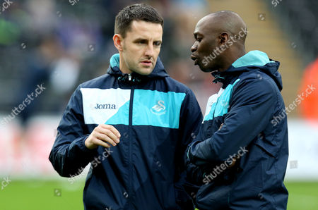 Swansea Performance Director Richard Buchanan and Assistant Manager Claude Makelele during the Premier League match between Swansea City and Arsenal played at the Liberty Stadium, Swansea on 14th January 2017