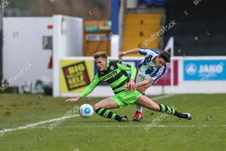 Forest Green Rovers Charlie Cooper(20) in first on a tackle during the FA Trophy 2nd round match between Chester FC and Forest Green Rovers at the Deva Stadium, Chester