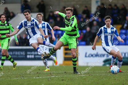 Forest Green Rovers Charlie Cooper(20) is tackled by Chester's Evan Horwood(3) during the FA Trophy 2nd round match between Chester FC and Forest Green Rovers at the Deva Stadium, Chester