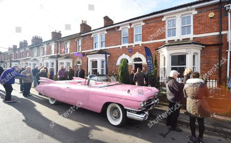 Diana's Pink Cadillac outside the house where she was born