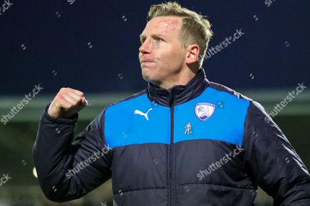 Stock Photo of Chesterfield caretaker Manager Ritchie Humphreys celebrates victory during the EFL Sky Bet League 1 match between Chesterfield and Coventry City at the Proact stadium, Chesterfield