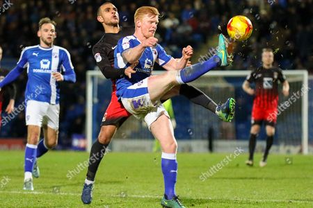 Chesterfield midfielder Liam O'Neil wins the ball as Coventry striker Marcus Tudgay challenges during the EFL Sky Bet League 1 match between Chesterfield and Coventry City at the Proact stadium, Chesterfield