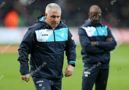 Assistant Coach Nigel Gibbs and Swansea Coach Claude Makelele.