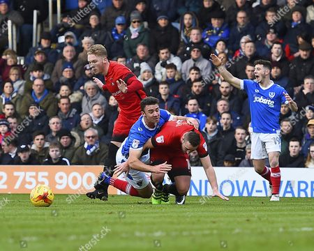 Enda Stevens of Portsmouth is brought down in the penalty area by Sammy Moore of Leyton Orient during Portsmouth vs Leyton Orient, Sky Bet EFL League 2 Football at Fratton Park on 14th January 2017