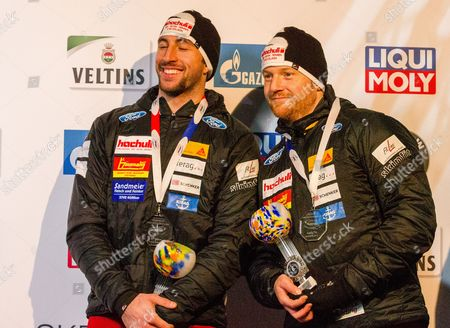 Rico Peter and Thomas Amrhein from Switzerland celebrate on the podium for the Men's Two-Man competition at the Bobsleigh World Cup in Winterberg, Germany, 14 January 2017.