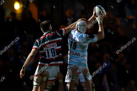 Racing Metro's Ali Williams, right, catches the ball next to Leicester Tigers' Michael Fitzgerald on a line out during their European Rugby Champions Cup match at Yves Du Manoir Stadium in Colombes, north of Paris, France, . Racing Metro won 34-3