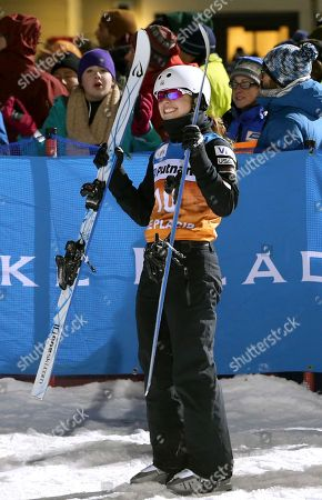 Ashley Caldwell holds up her skis after wining the women's freestyle World Cup aerials competition, in Lake Placid, N.Y