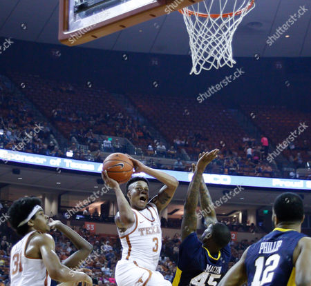 Texas Longhorns guard Jacob Young (3) goes up for a shot over West Virginia Mountaineers forward Elijah Macon (45) in the first half during the NCAA Men's Basketball game between the West Virginia Mountaineers and the Texas Longhorns at the Frank Erwin Center in Austin, TX